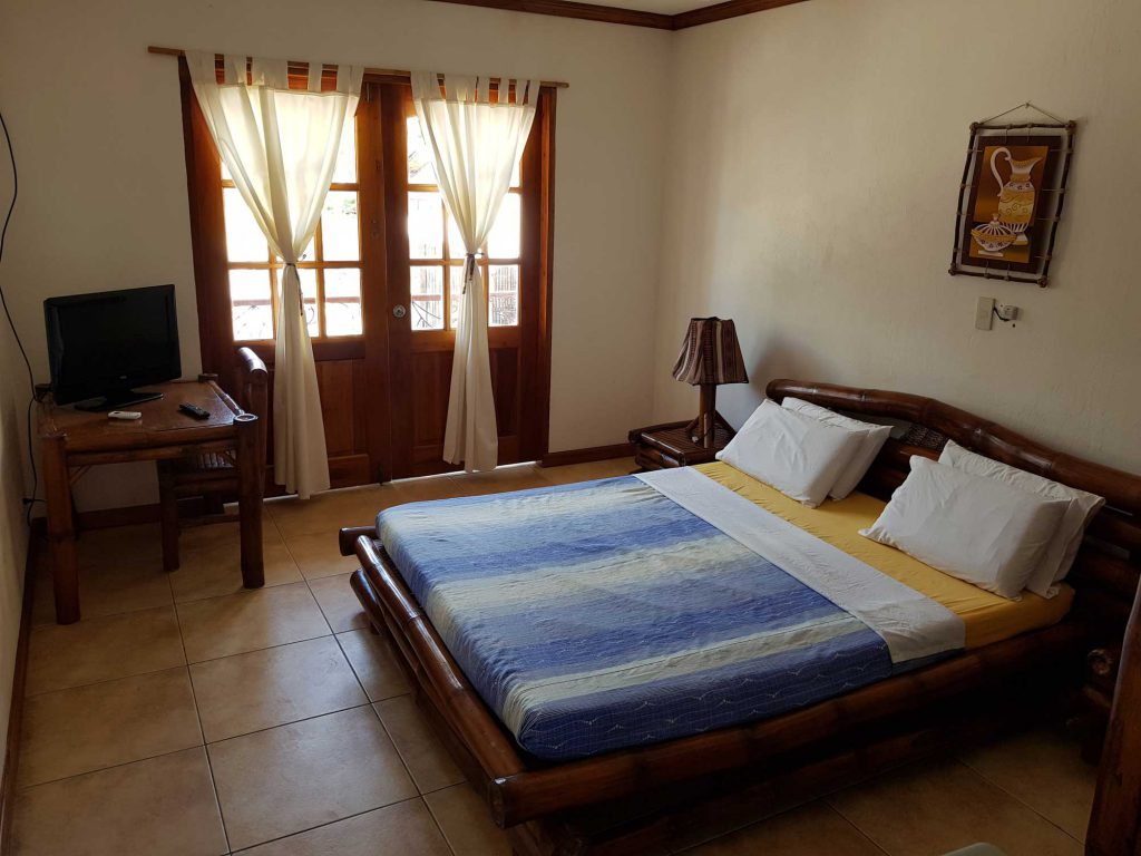 Villa Queen Bed room at Tipolo beach resort Moalboal