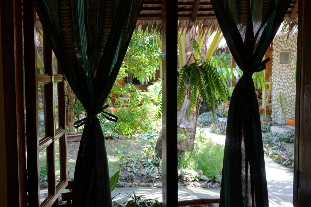 Window view from Seaside Twin bed room Tipolo Beach resort